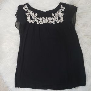 Black maternity top with white floral embroidery